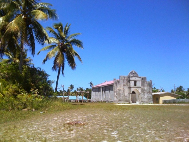 The entrance of a coconut plantation on a South Pacific Island