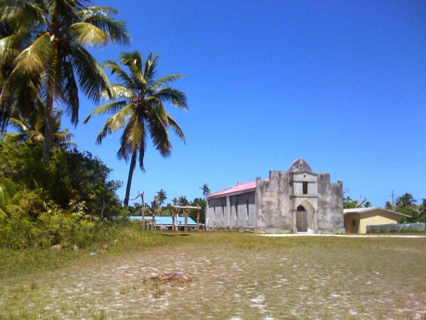 church next to coconut trees plantation