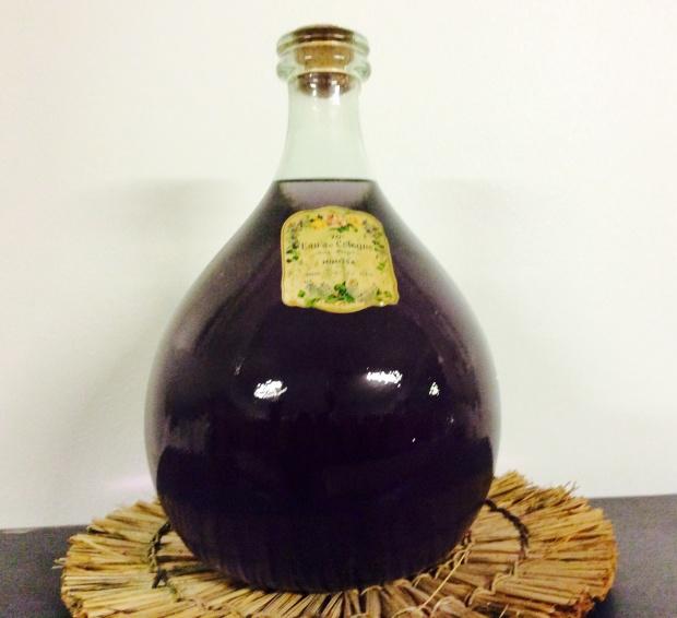 Old violet perfume bottle photography